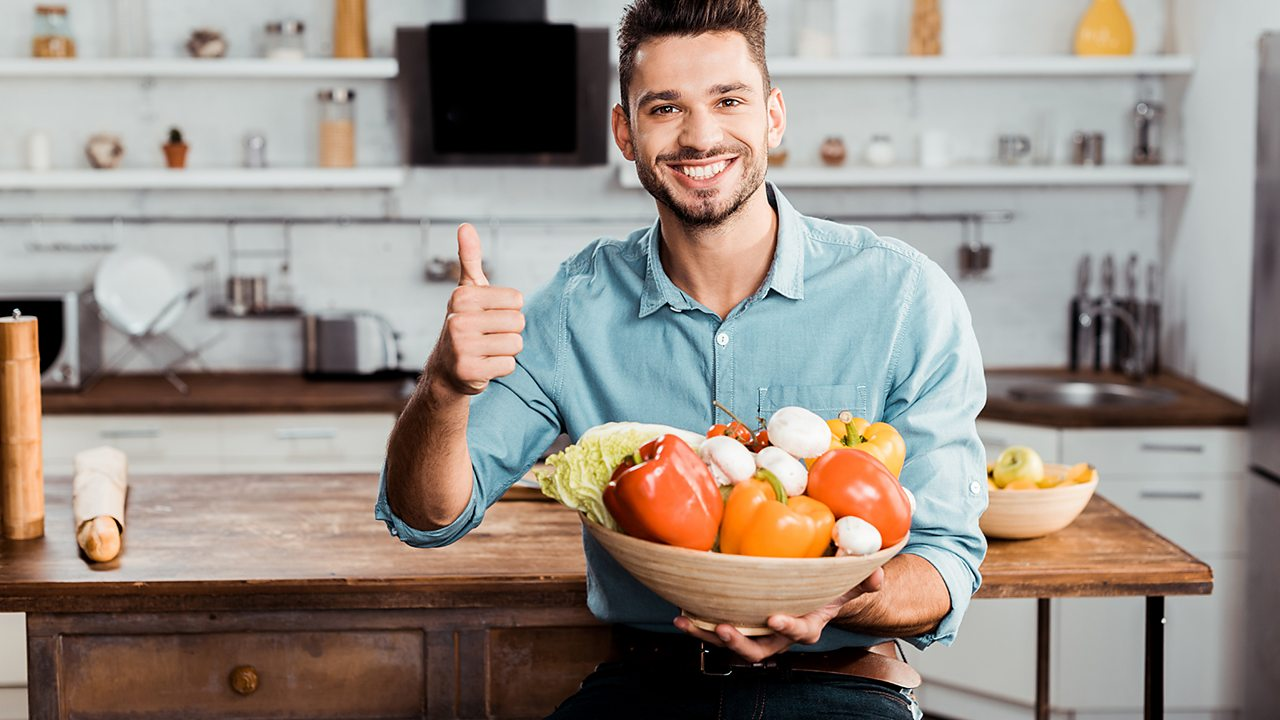 Happy man holding fruit