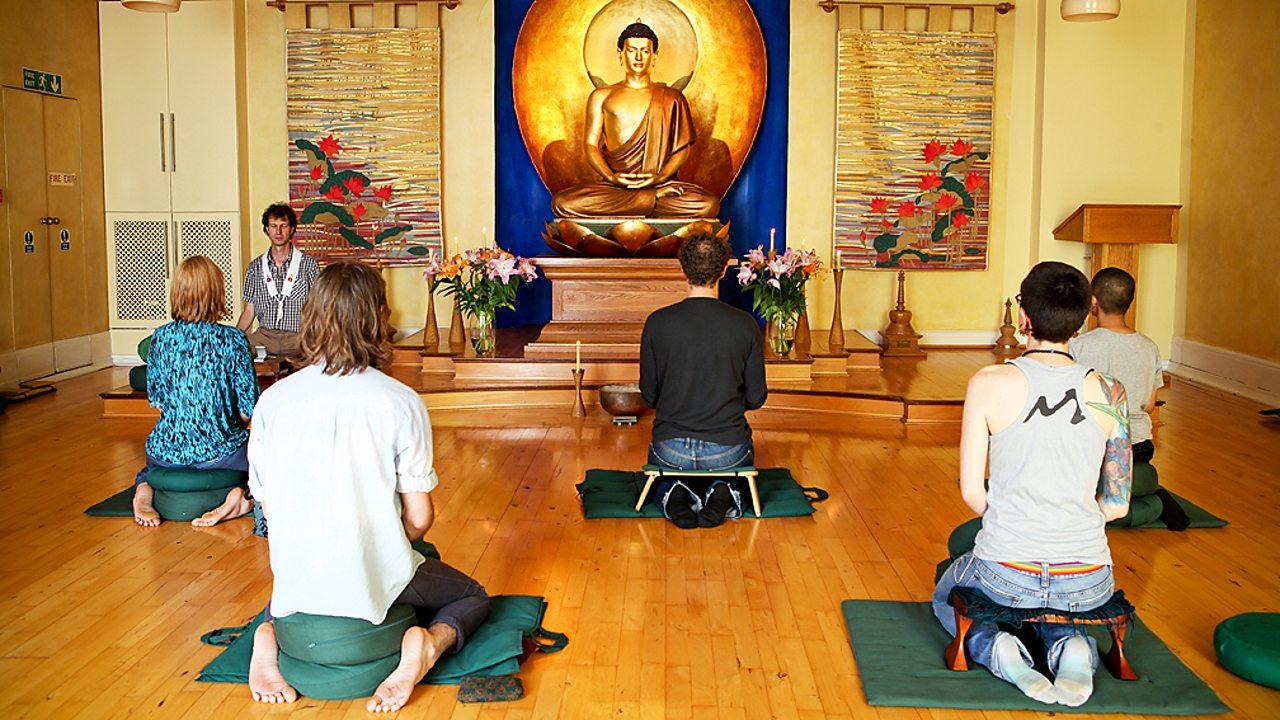 People meditating