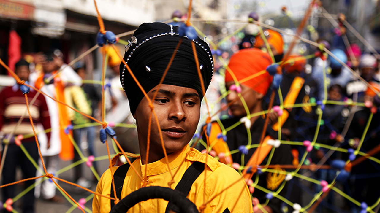 A young Indian Sikh taking part in a procession