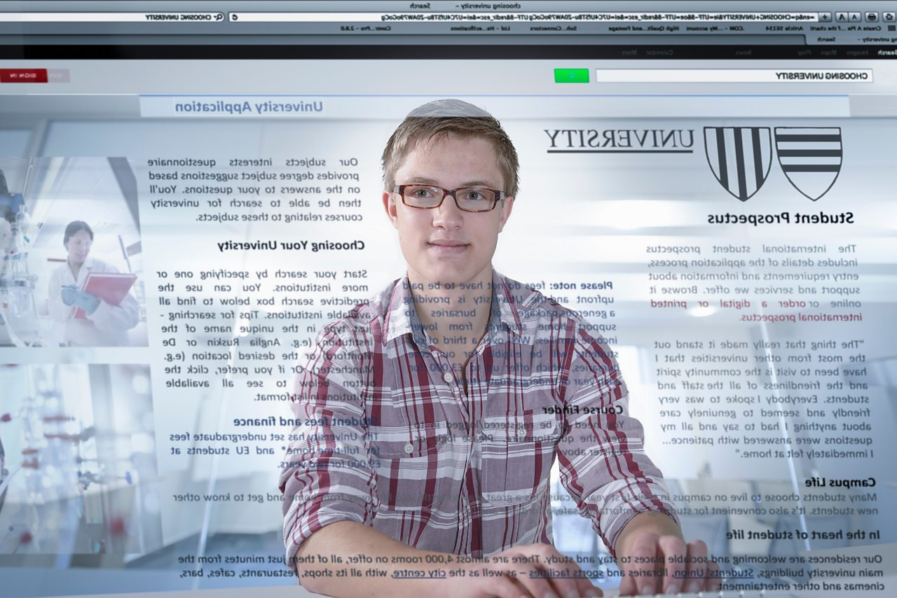 A student views University details, reflected back at him from a computer screen