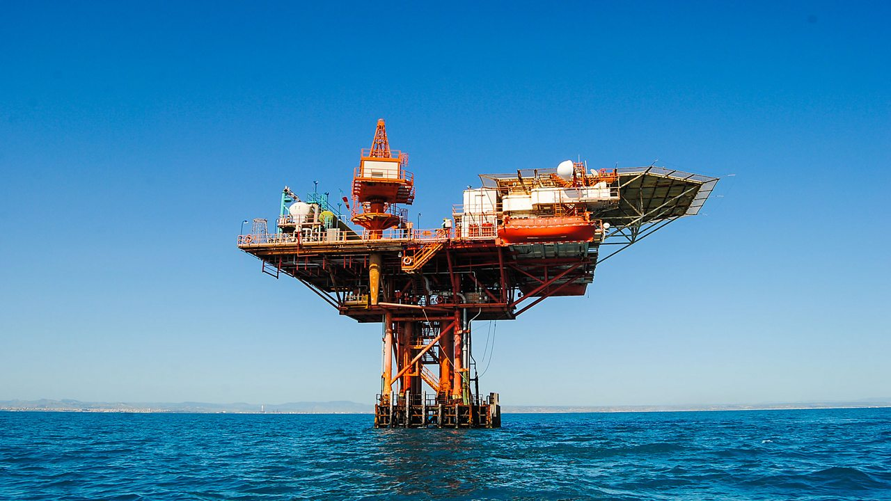 An oil rig pumps oil from the ground. Oil is also a fossil fuel which we use to fuel vehicles and machines.