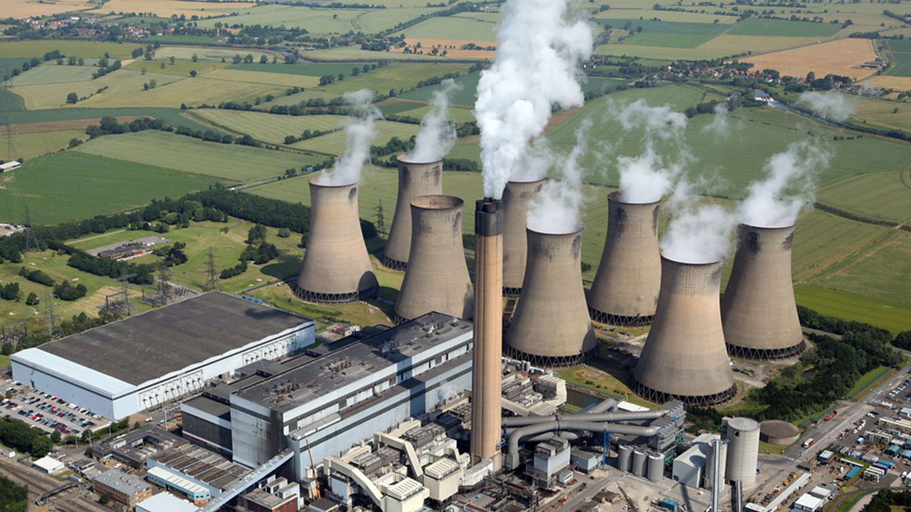This is a coal power station in the UK. Coal is a fossil fuel which is often used for providing heat.