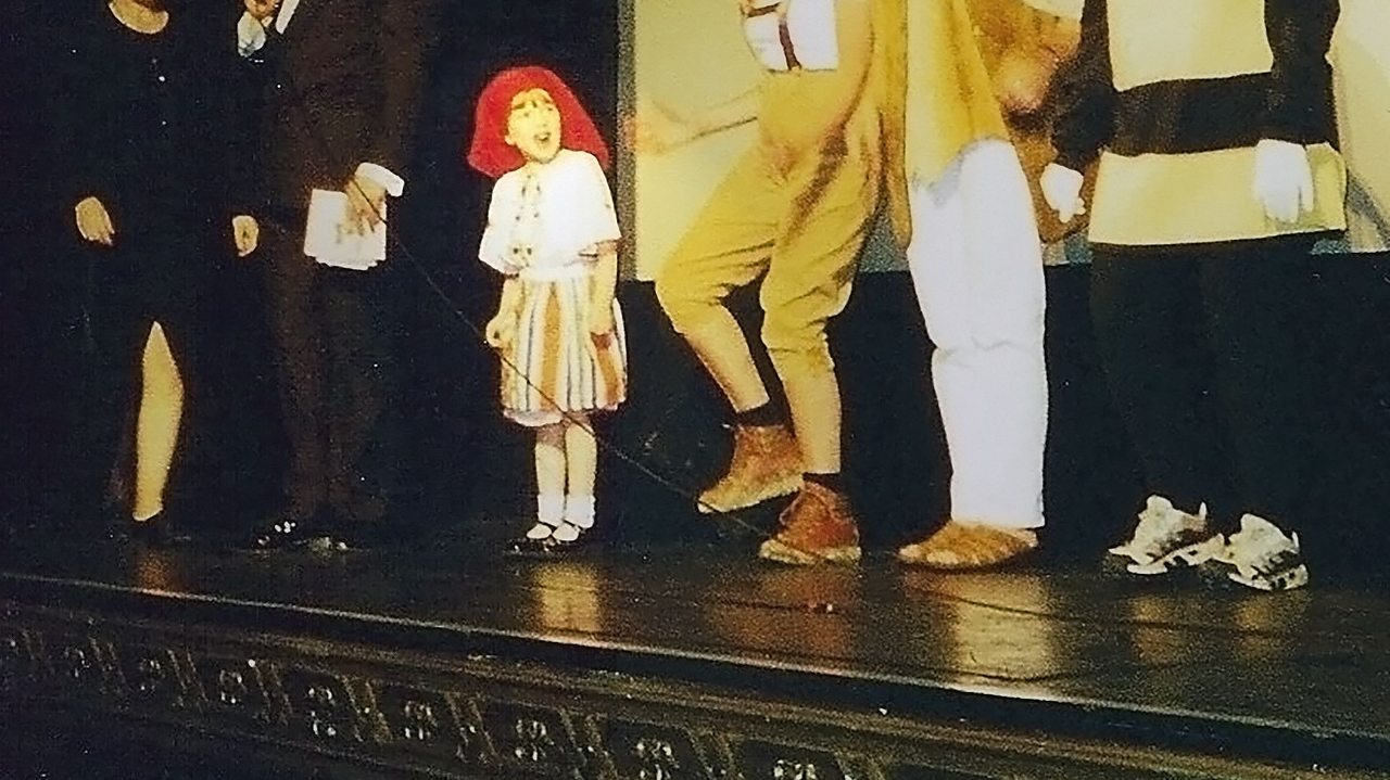 Megan on stage as a child