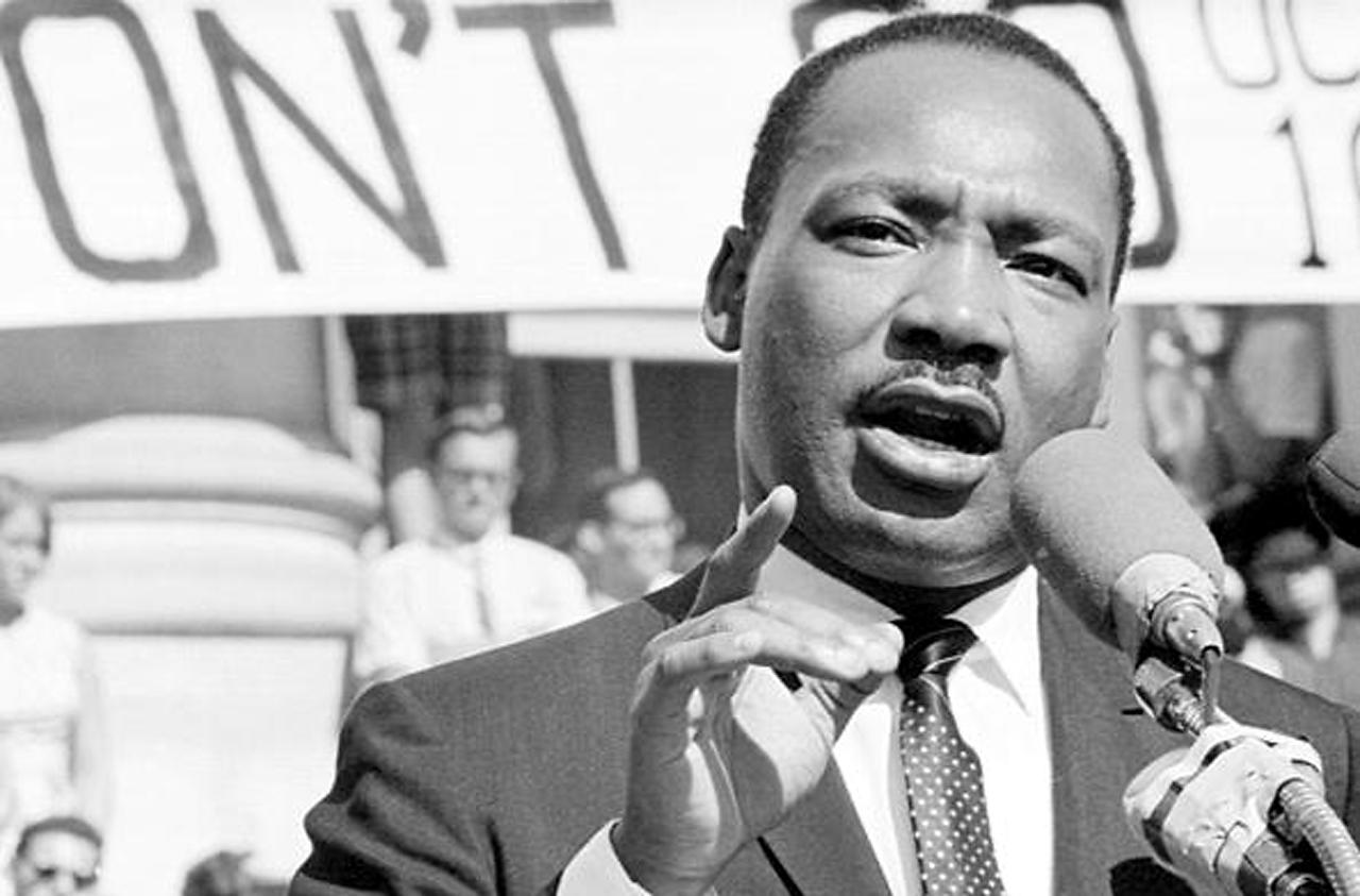 Photograph of Dr Martin Luther King, speaking at a rally.