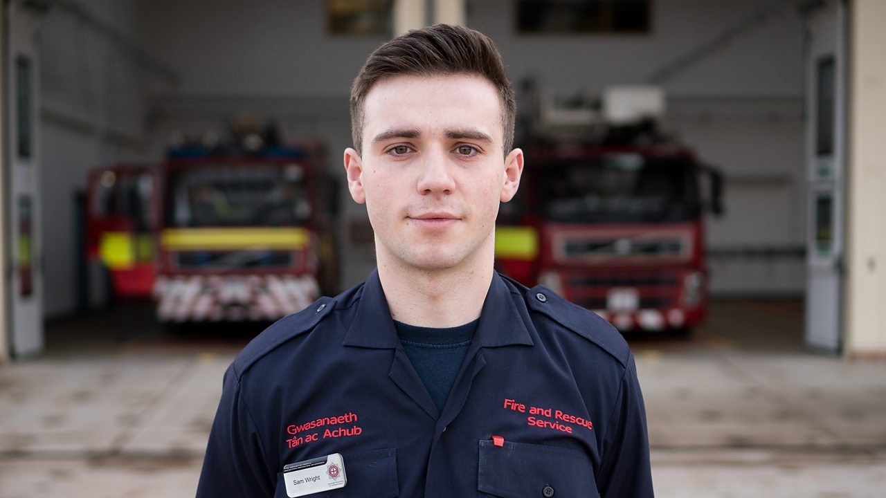 Sam in uniform outside the fire station.