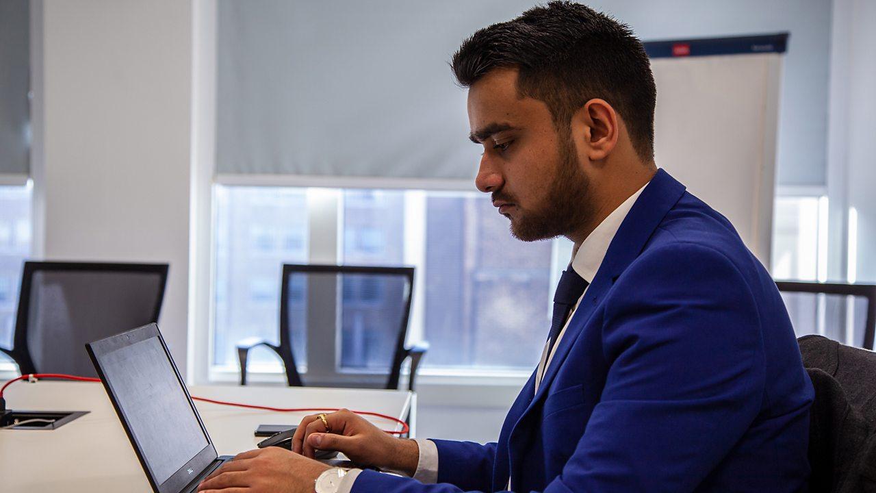 Ekansh working on a laptop