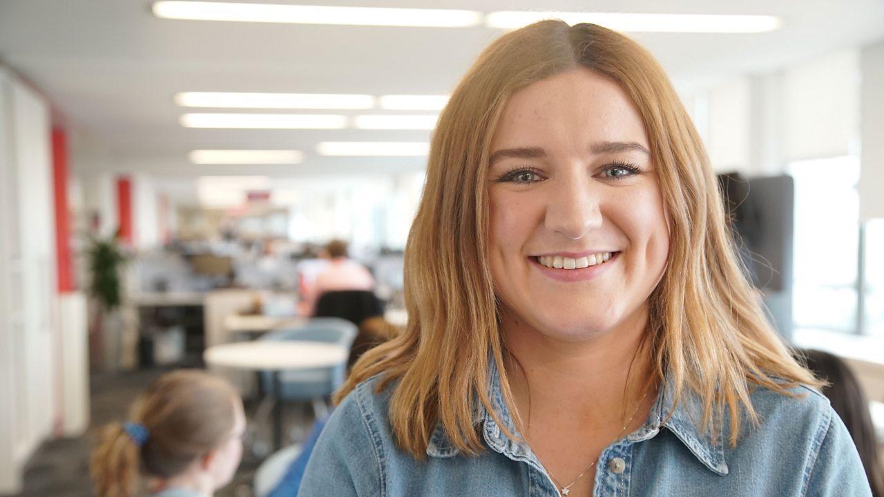 Ailish at work, smiling at the camera.