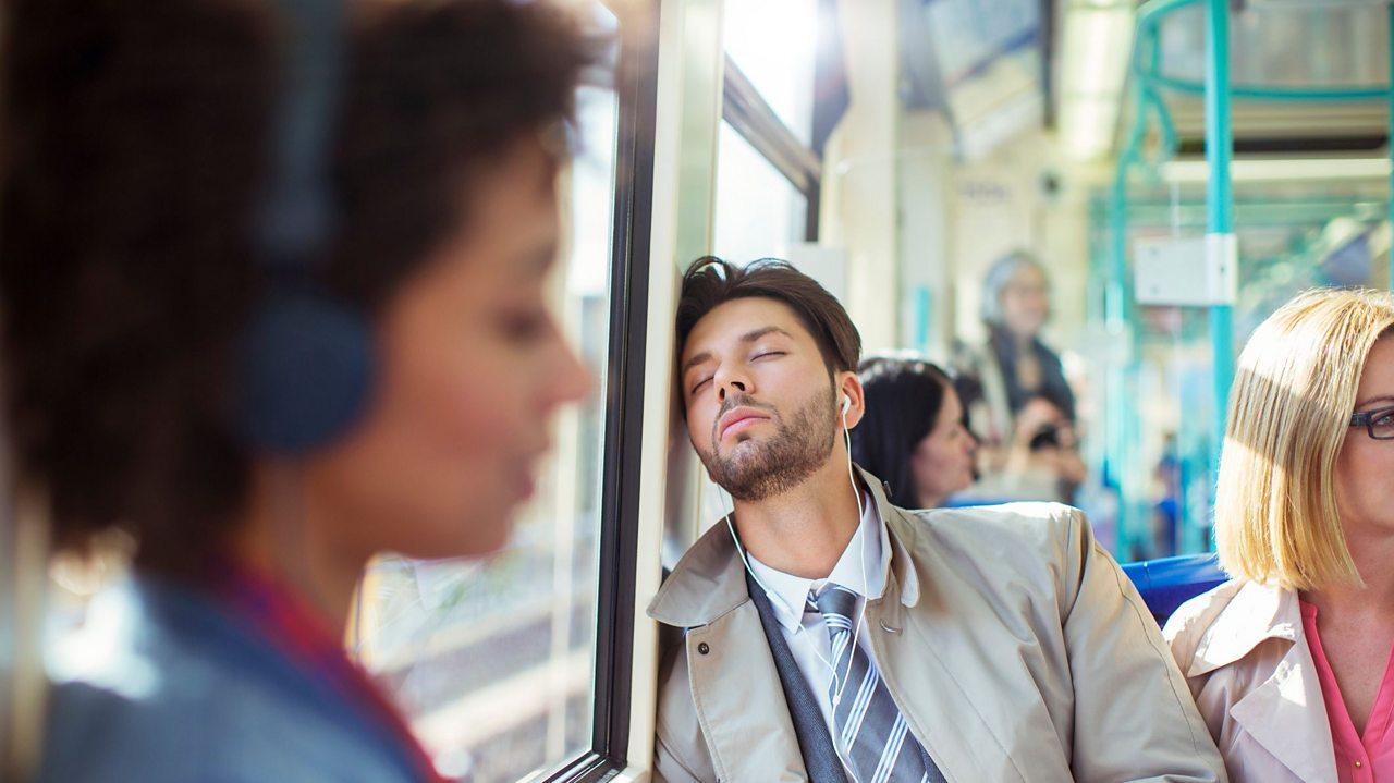 Man falling asleep on public transport