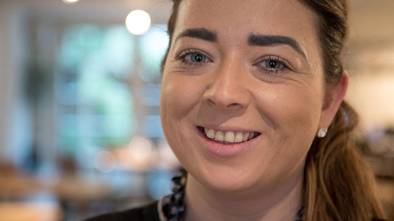Larissa smiling.