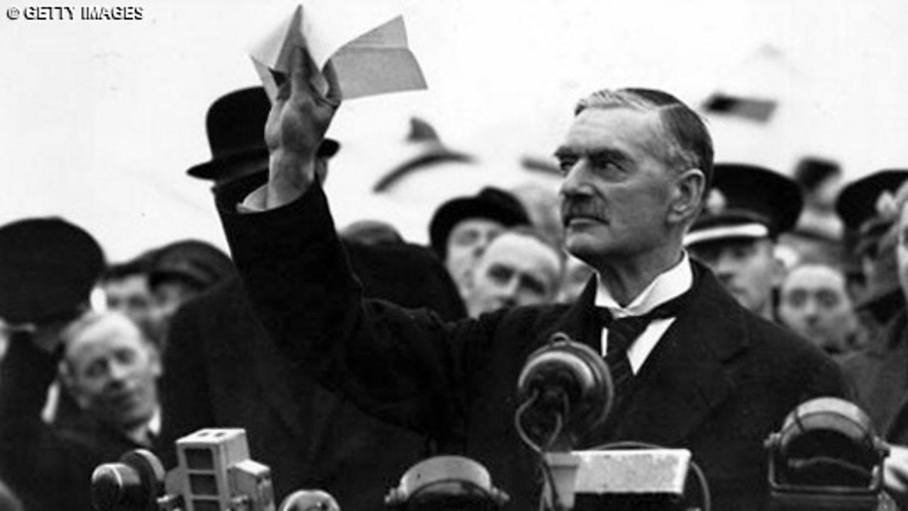 Chamberlain returns from Munich