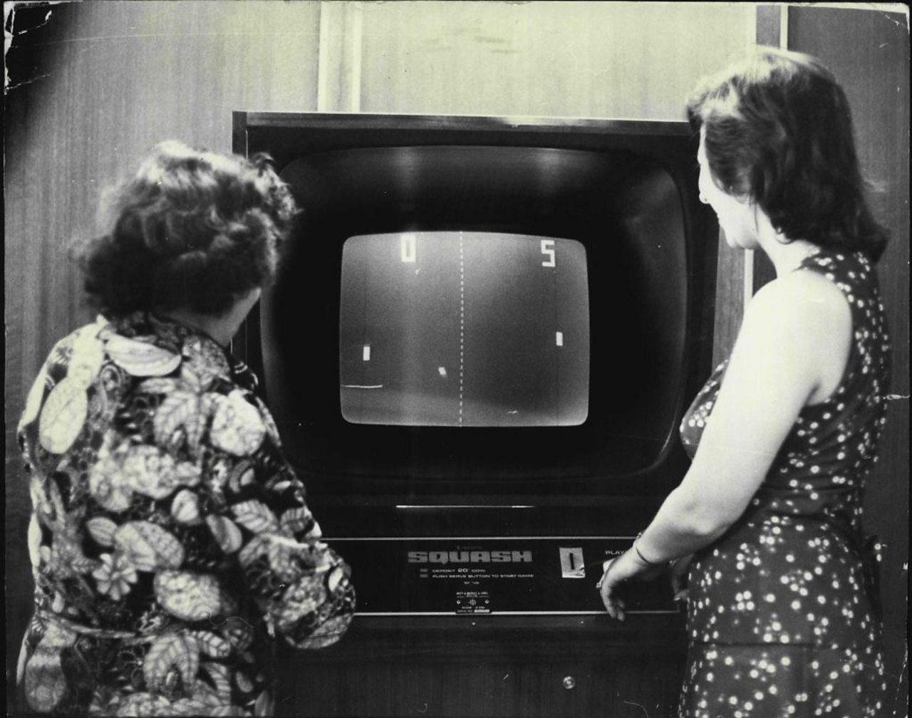 two women playing the first games console