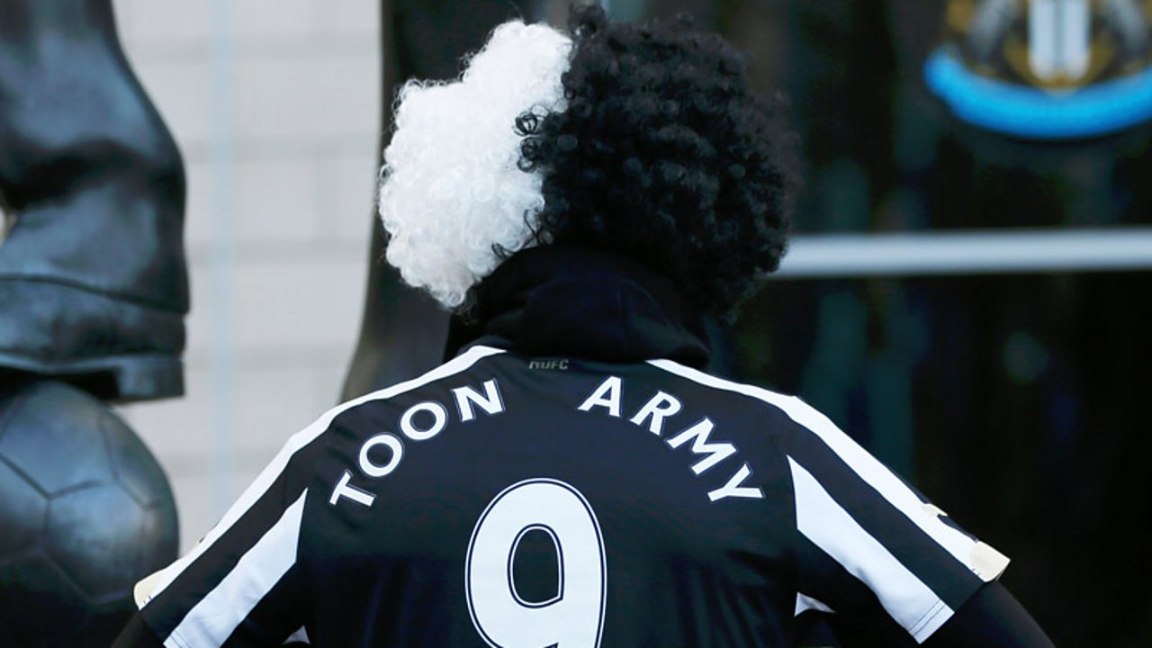 """A Newcastle fan wearing a top saying """"toon army"""""""