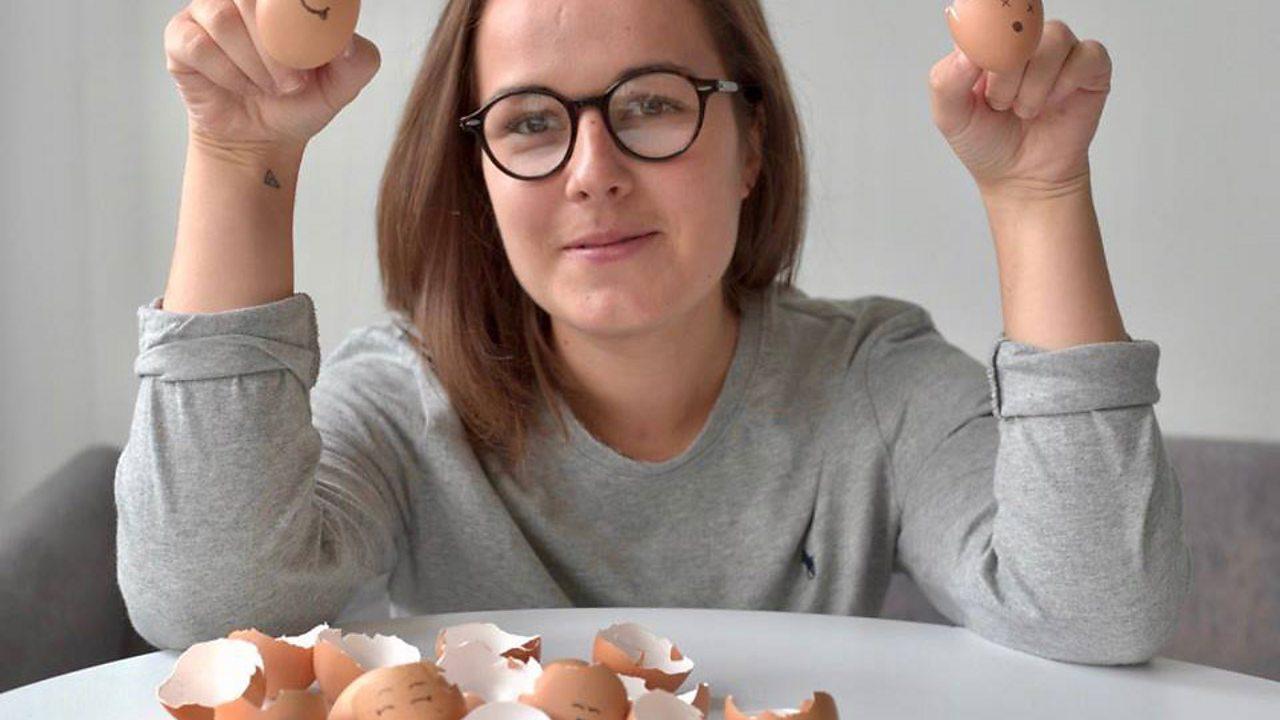 Lara holding two eggs.