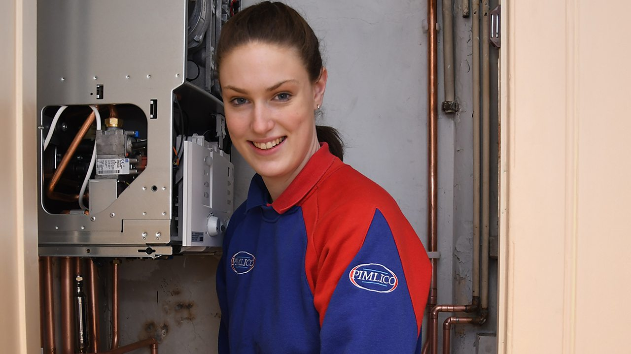 Sophie at work, next to a boiler.