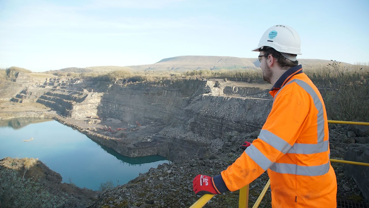 Alex looking out over a quarry at work.