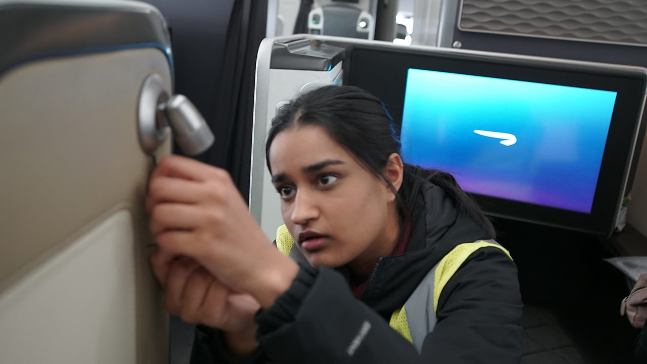 Balwant repairing a fault inside the aircraft.