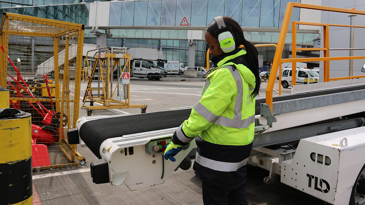Shannon guiding a baggage handling conveyor into place.