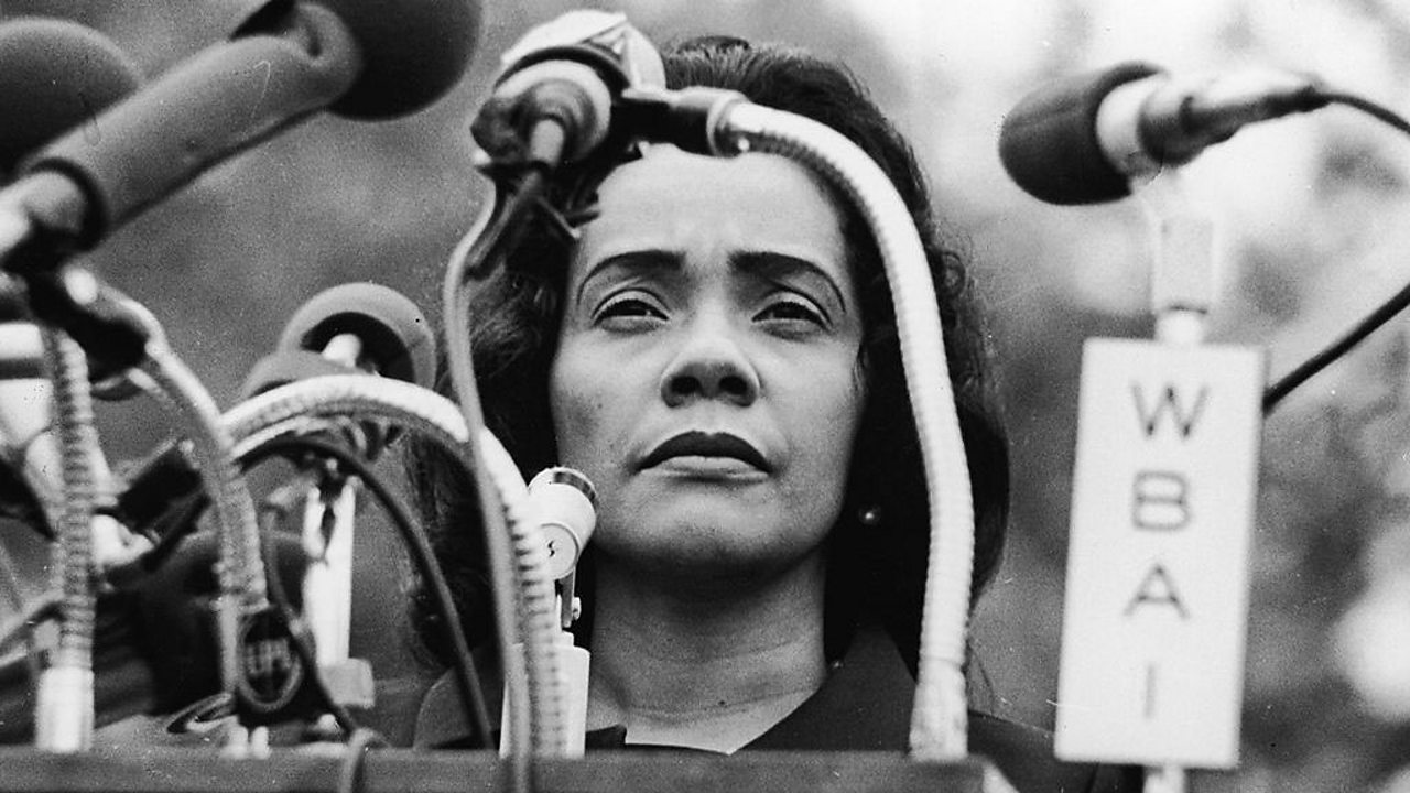 Coretta Scott King standing behind a podium at Peace-In-Vietnam Rally, Central Park, New York, April 27, 1968.