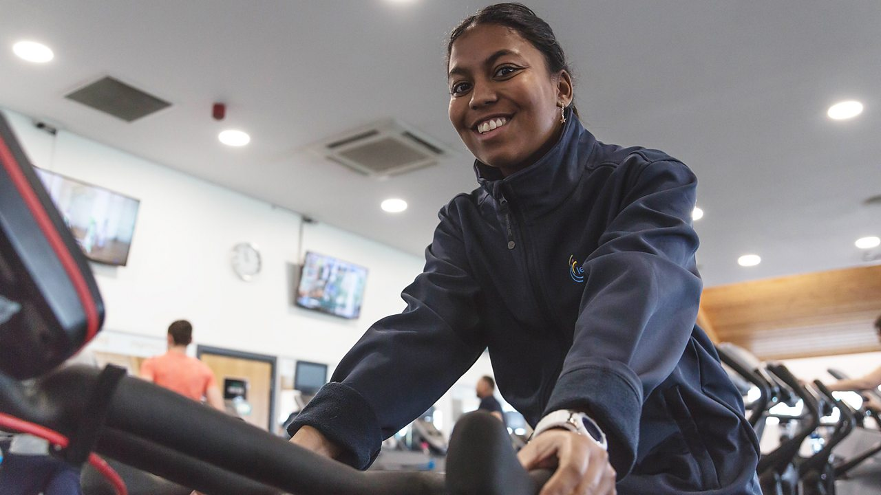 Lia on an exercise machine at the leisure centre