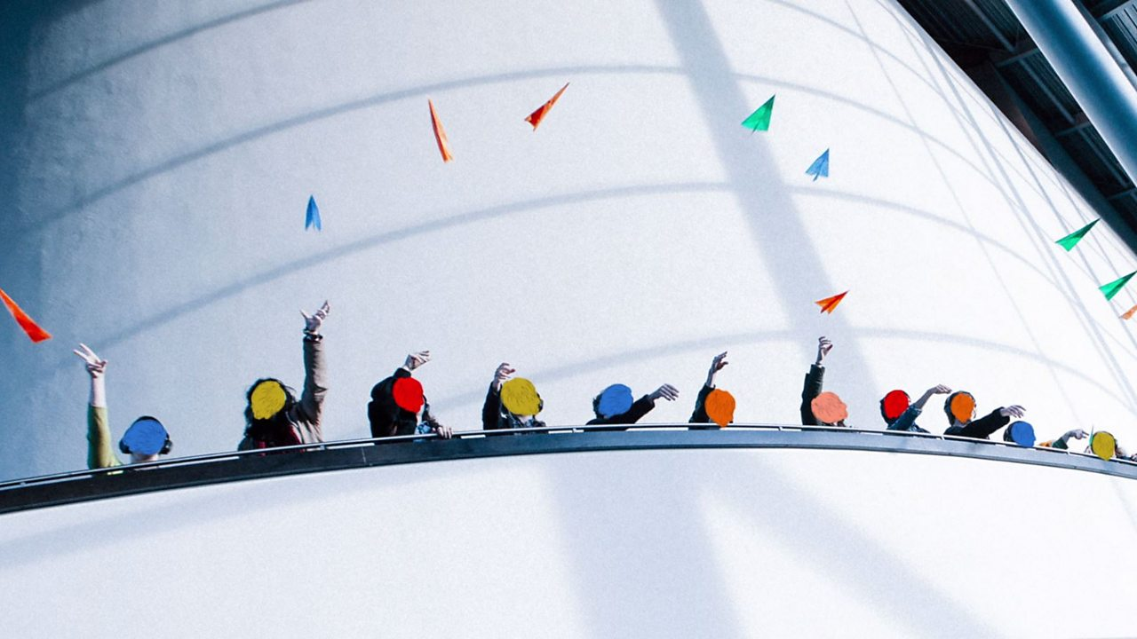 An image of people throwing colourful paper planes into the air.