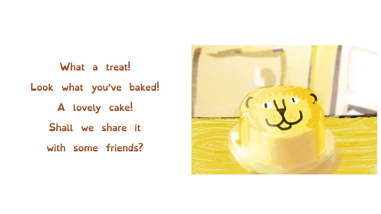 A cake that has been iced and decorated with a lion face design.