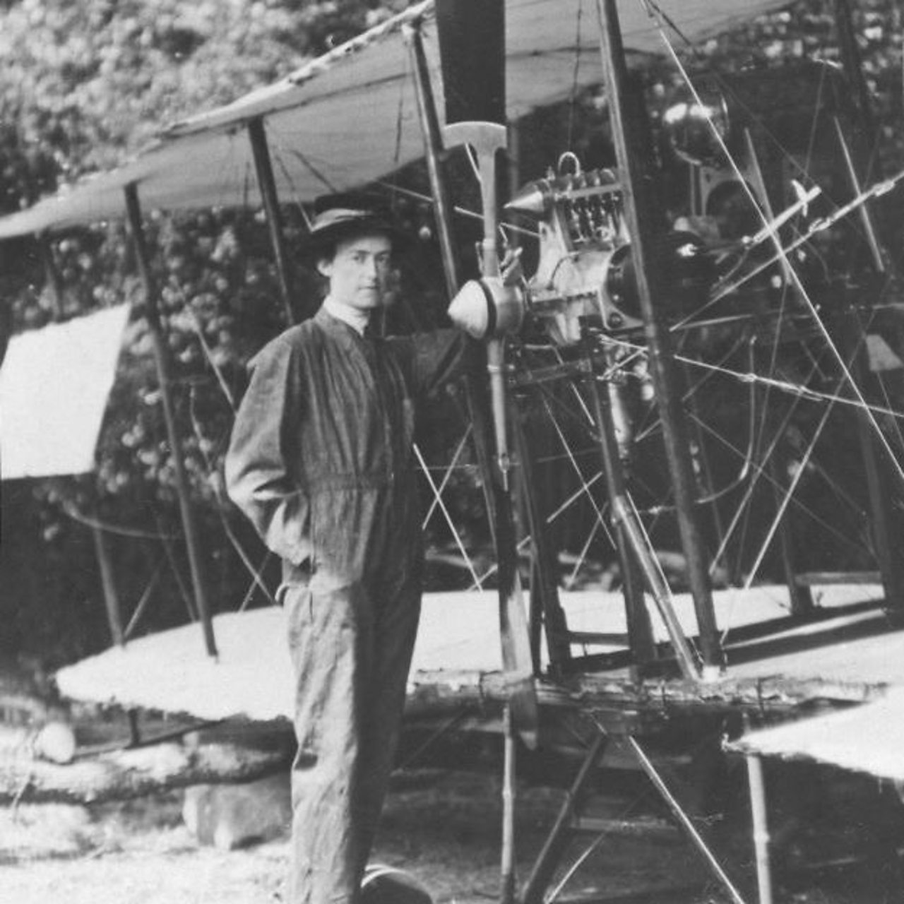 Photograph of Lilian Bland standing in front of her aeroplane the 'Mayfly'