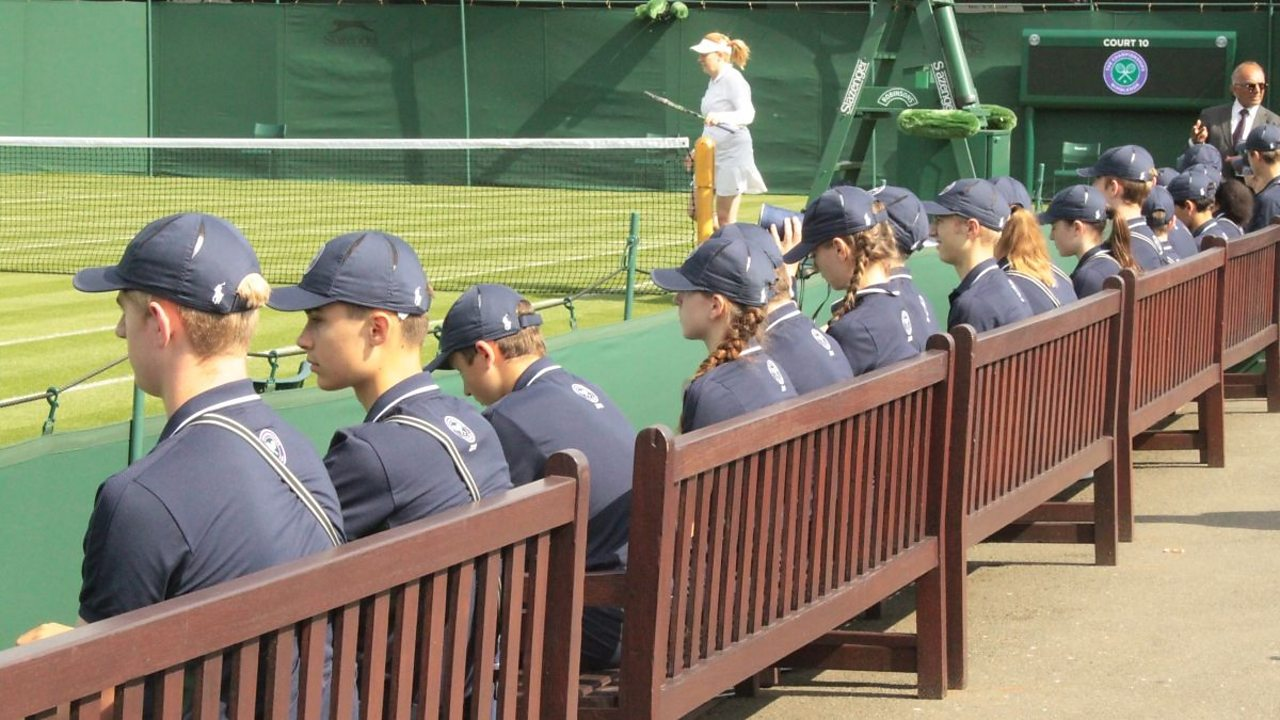 Ball boys and ball girls sitting in a line