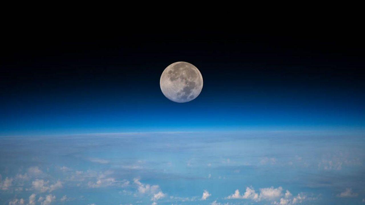the moon above the earth