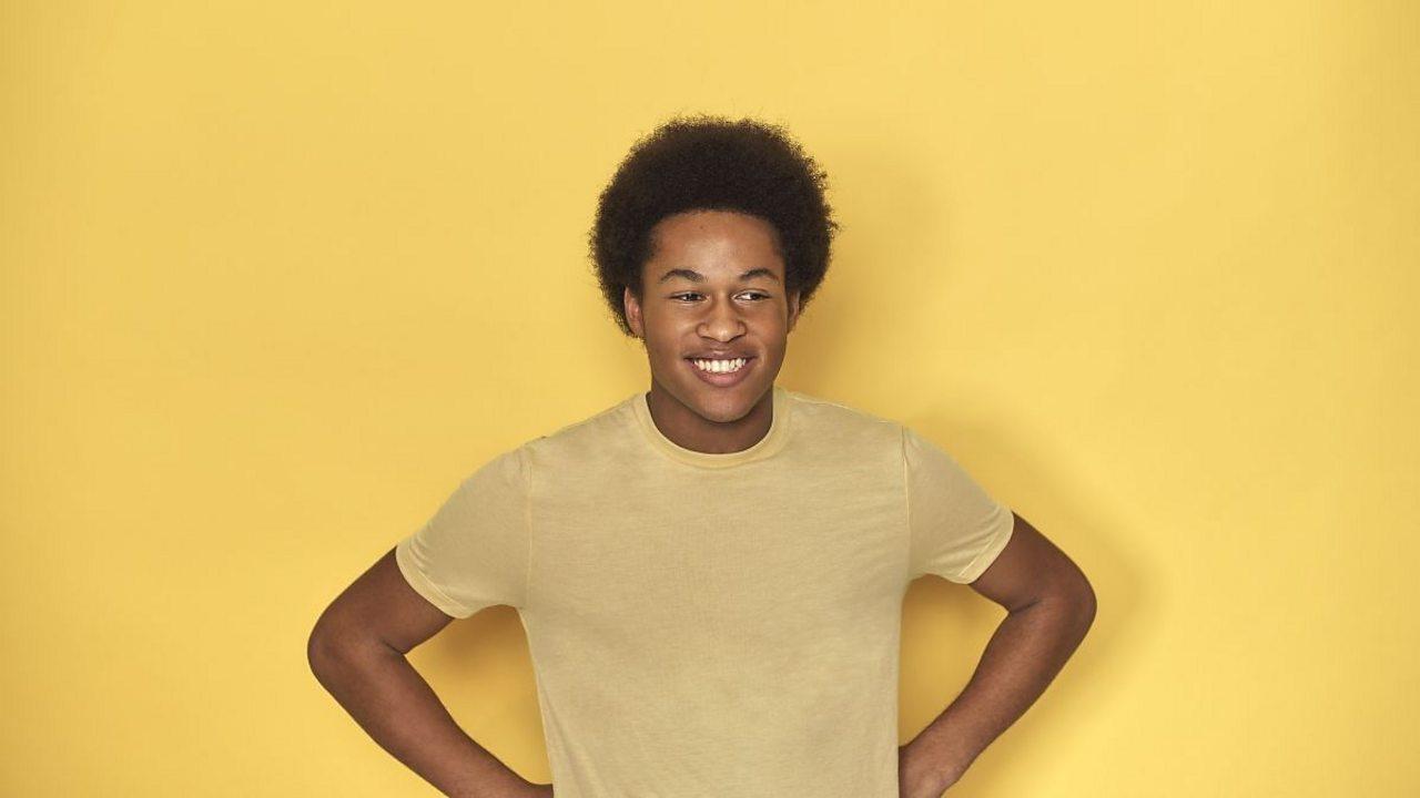 Sheku Kanneh Mason yellow background