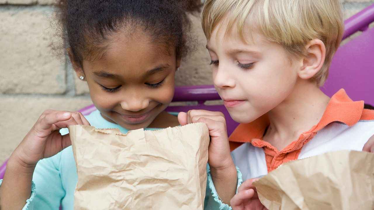 Boy and girl looking in a bag