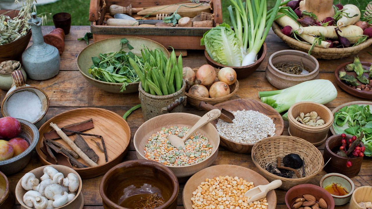 Table of medieval food including nuts seeds berries vegetables and pulses at a historical reenactment