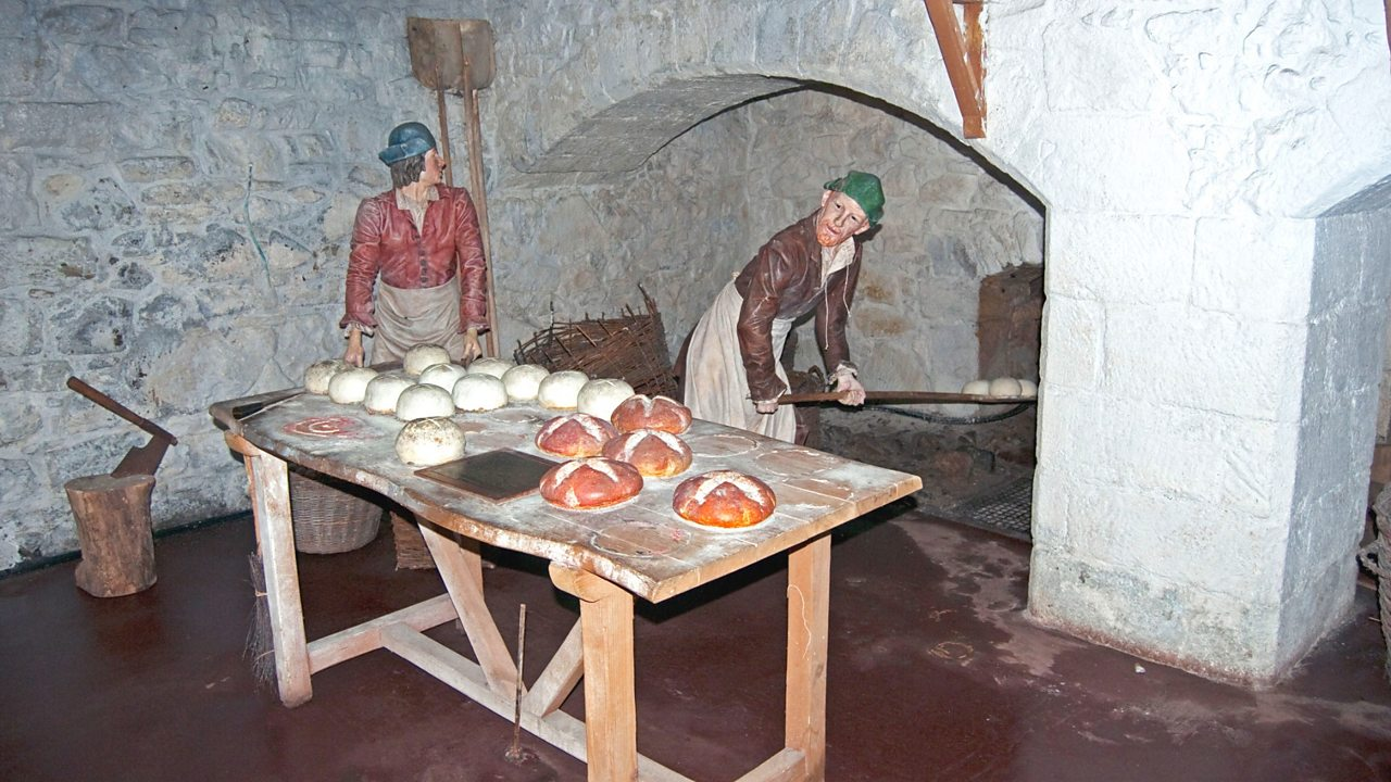 Reenactment of bread being baked in a medieval kitchen at Stirling Castle