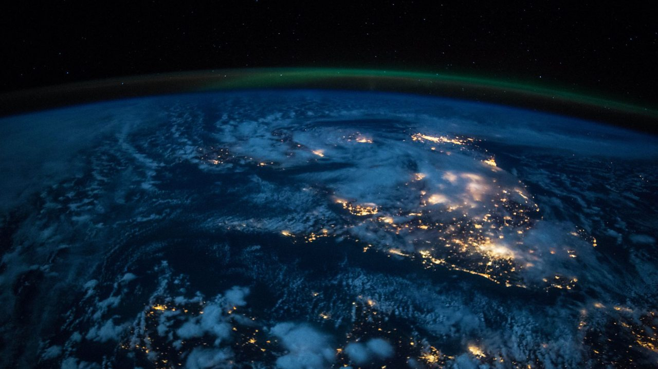 An image of Earth from space with a blue-green hue.