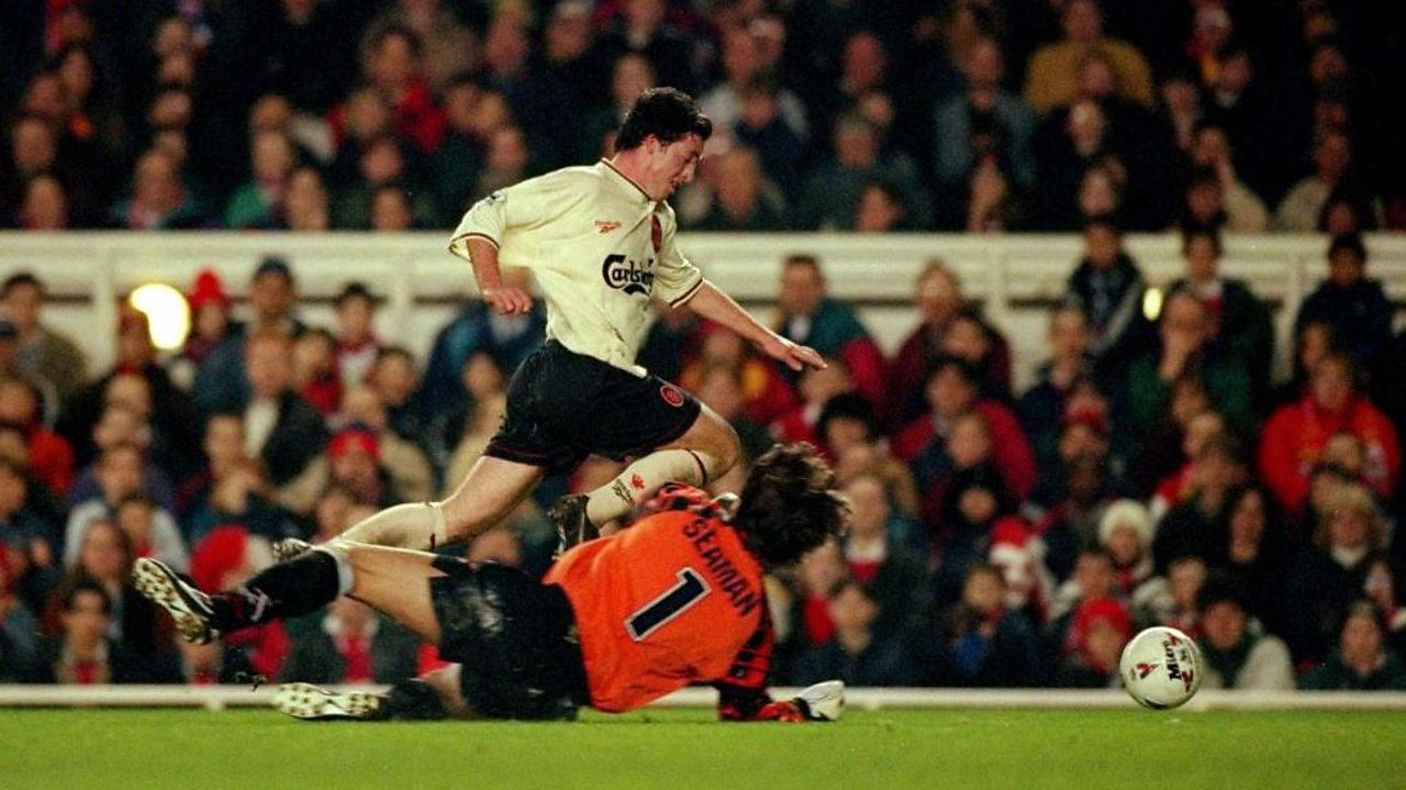 Liverpool's Robbie Fowler is brought down by Arsenal goalkeeper David Seaman