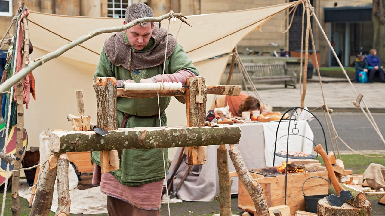 Man using a lathe at a re-enactment of a medieval fayre