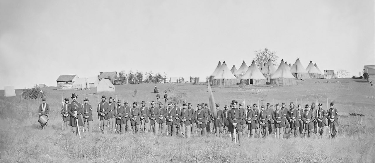A photo showing a line of soldiers during the American Civil War.