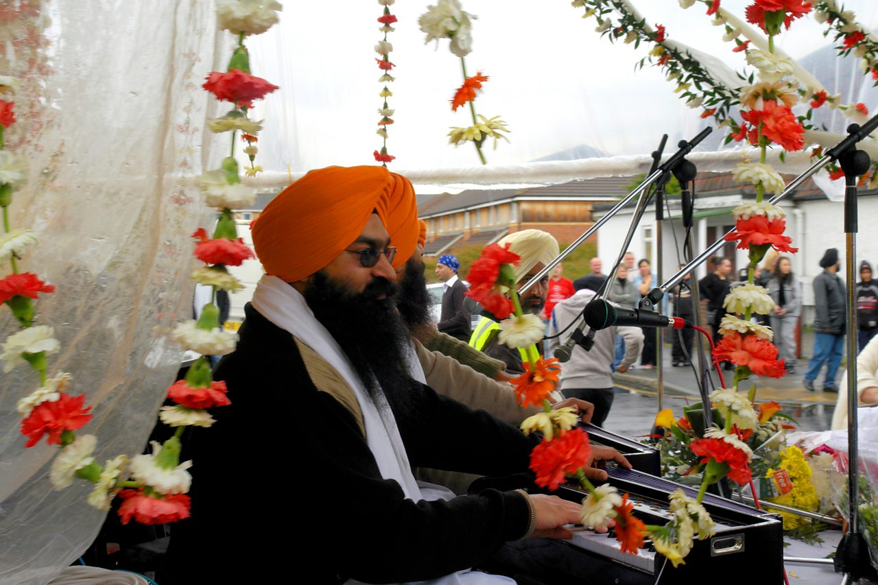 Sikhs celebrating Vaisakhi with music and flower garlands.