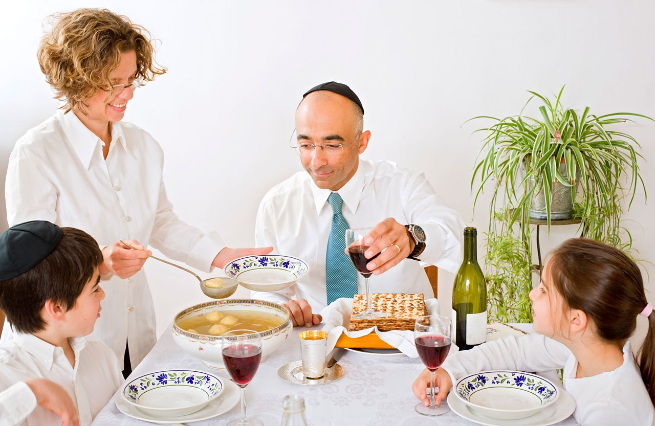 Family eating a Passover Seder meal.