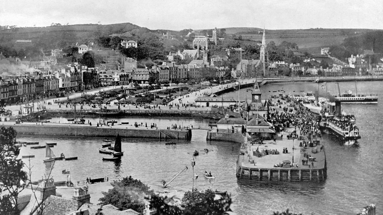 Paddle steamer at Rothesay harbour and a view across the bay