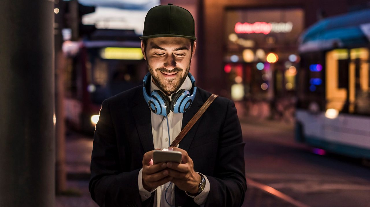 Man walking home on phone