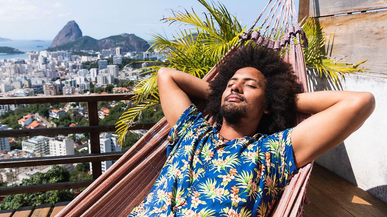 A man relaxing in a hammock.
