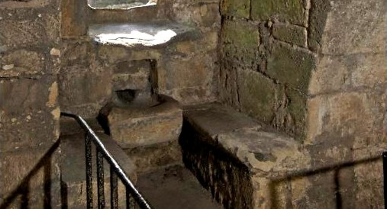 Detail of the slop basin in one of the window embrasures in the tower house kitchen at Lochleven Castle