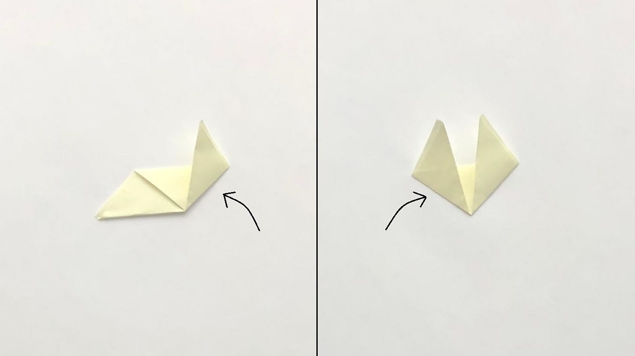 The remaining corners are folded up towards the top edge to make the fox ears.
