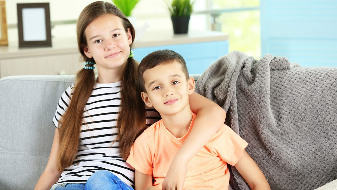 A brother sits with his older sister