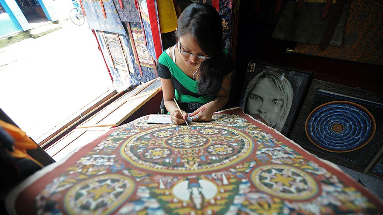 Buddhism – Painting a mandala