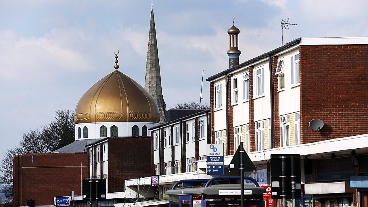 Christianity – A church and a mosque stand side by side in Birmingham