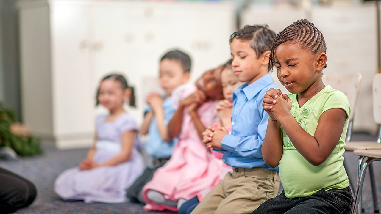 Non-religious beliefs – Children in school praying