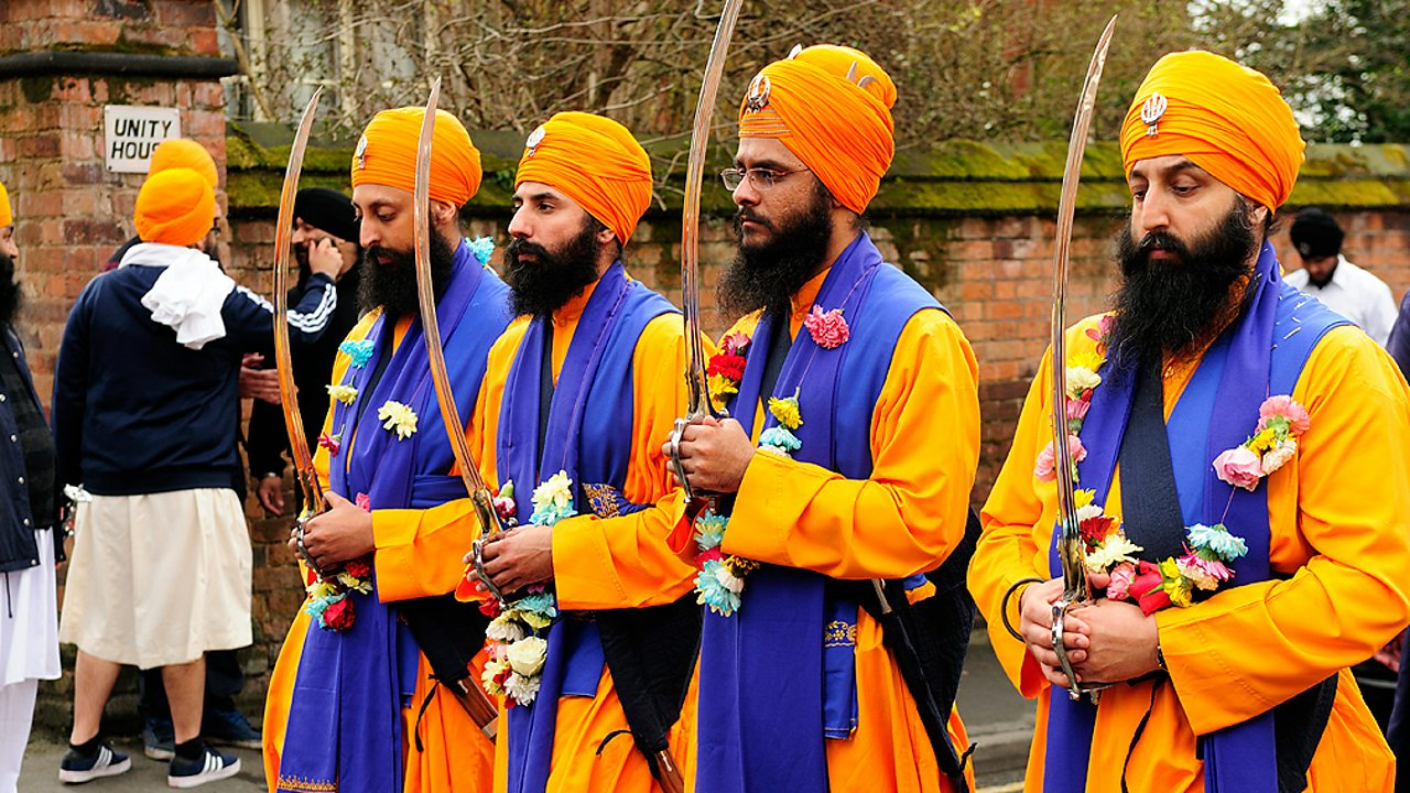 Sikh men marching in a Nagar Kirtan