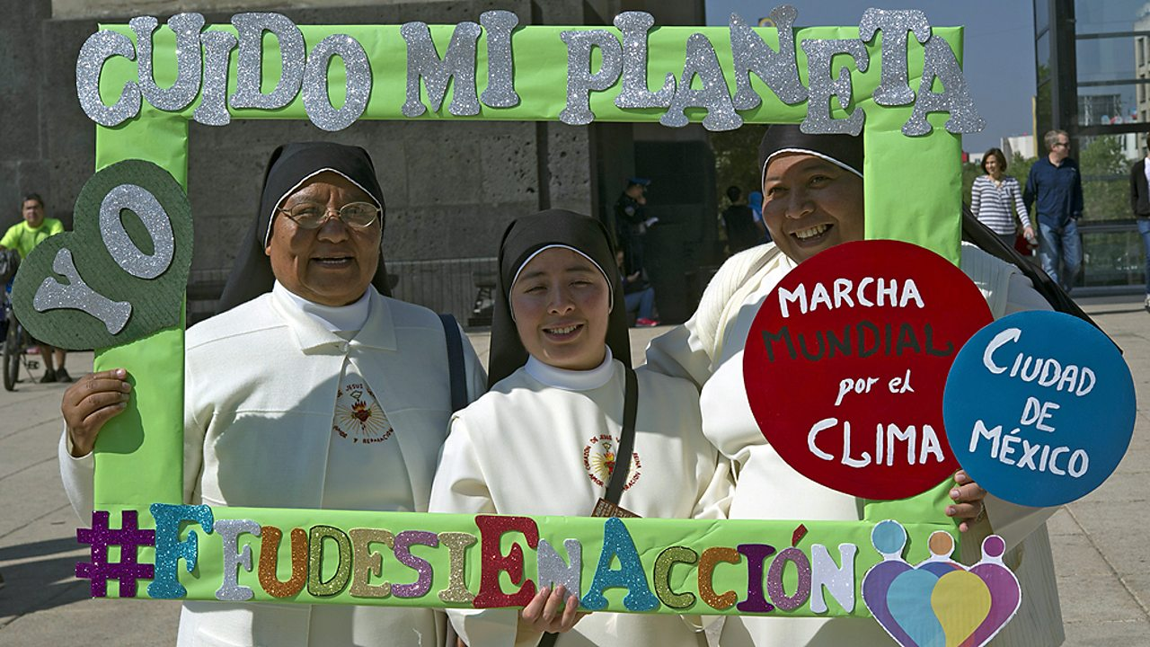 Christian nuns pose with a frame reading 'I take care of my planet' at the Global Climate March in Mexico City
