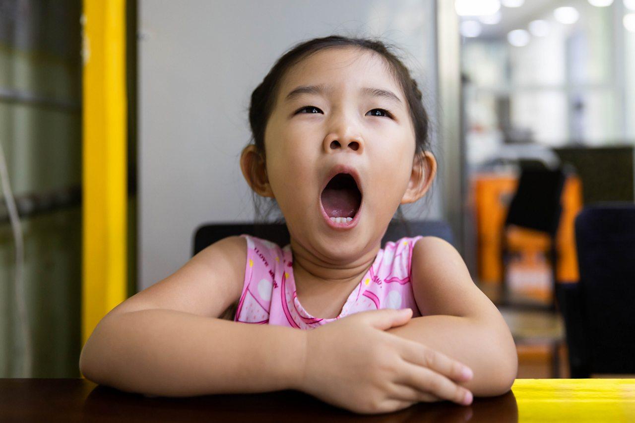 Little girl yawning